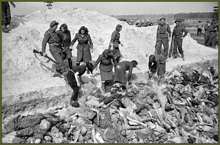 Female SS soldiers fill a mass grave with corpses while under guard by British soldiers at the Bergen-Belsen concentration camp, 1945