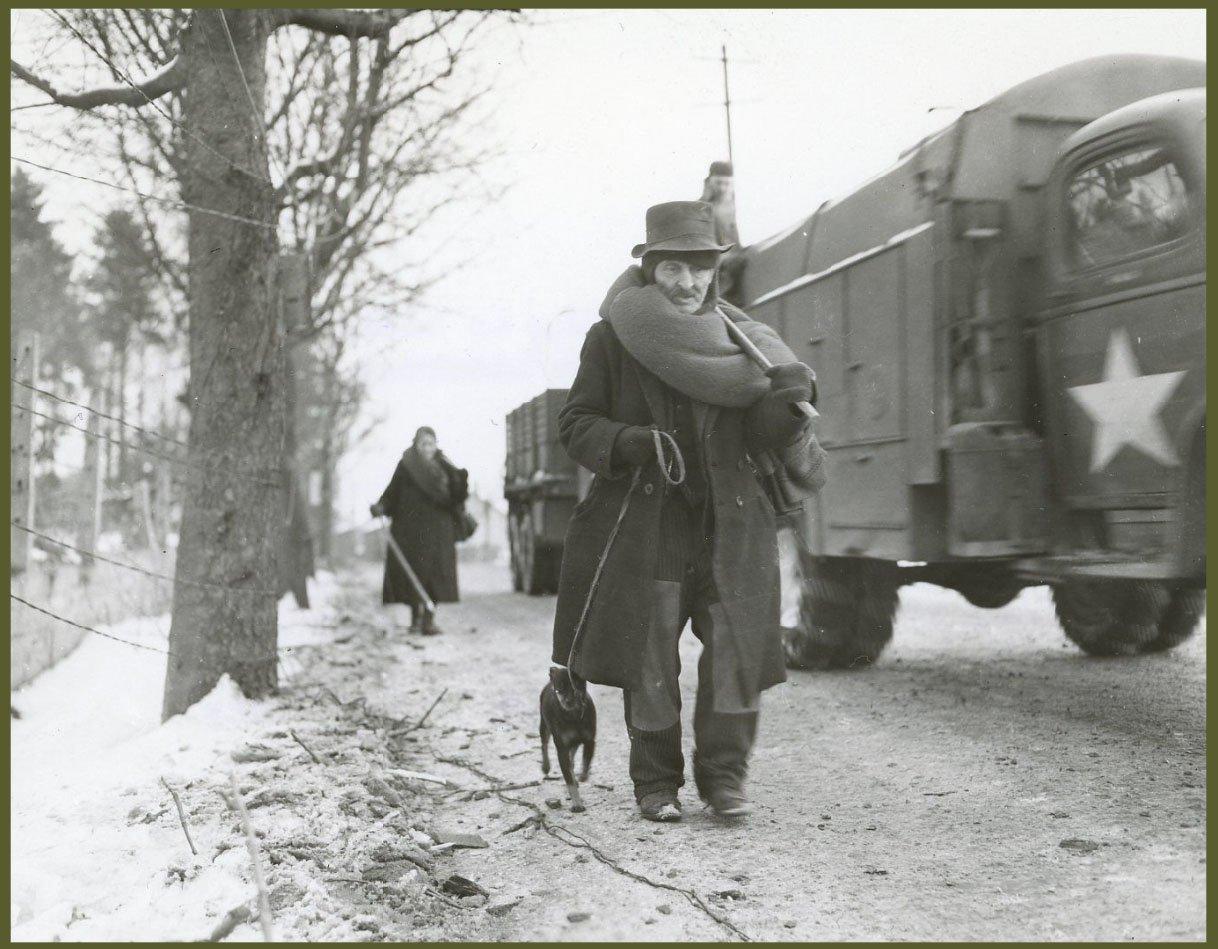 Belgian Civilians Walk Along a Road in Lierneux, Belgium
