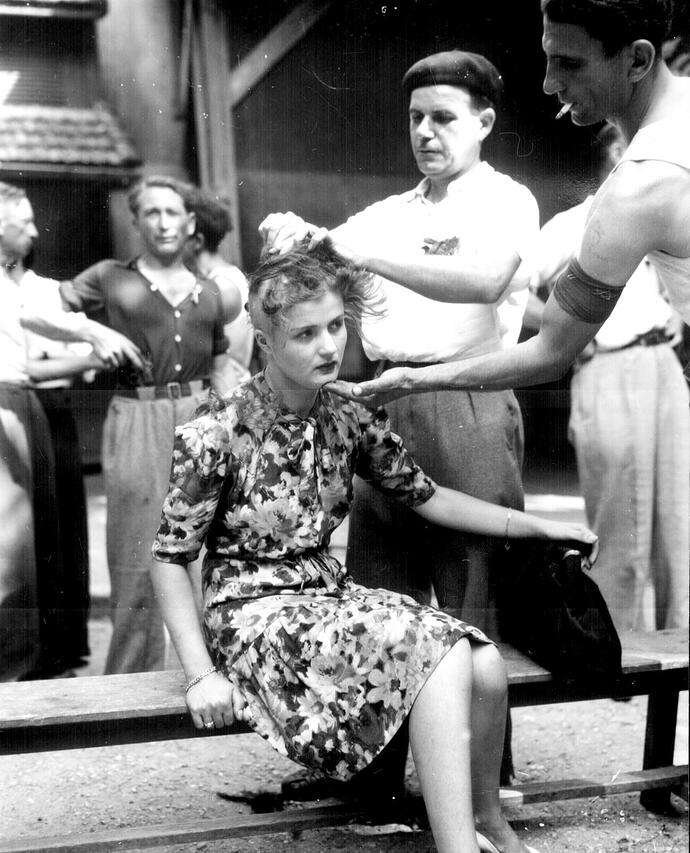 This girl pays the penalty for having had personal relations with the Germans August 1945.jpg